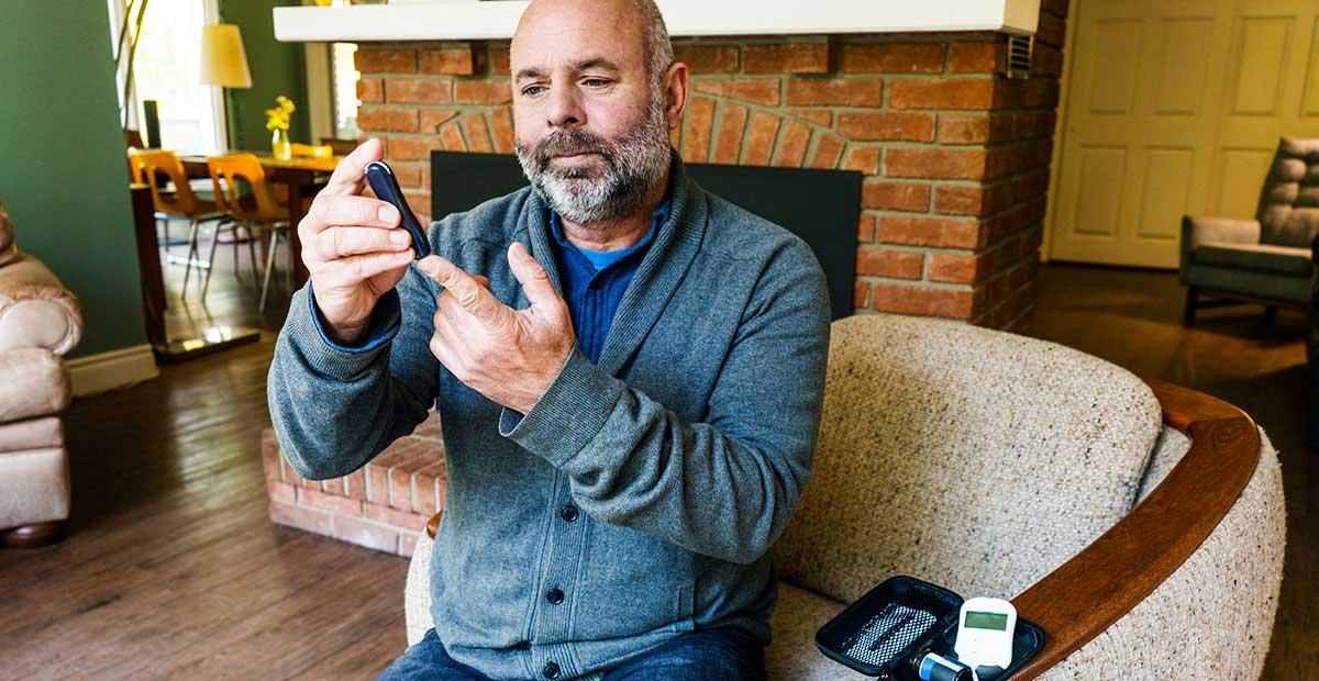 Man Testing Blood Glucose